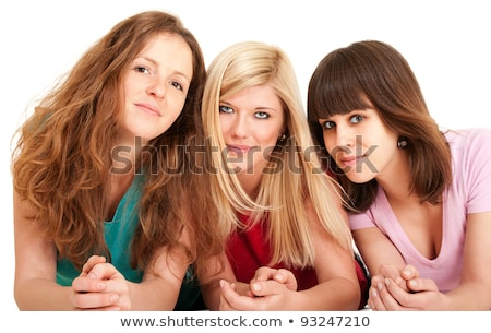 three beautiful brunette blonde and redhead girls lying down stock photo © pekour