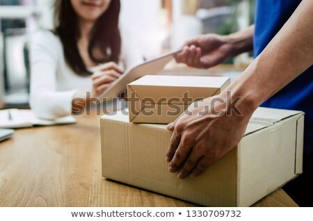 Surprised woman with an office clipboard Stock photo © photography33