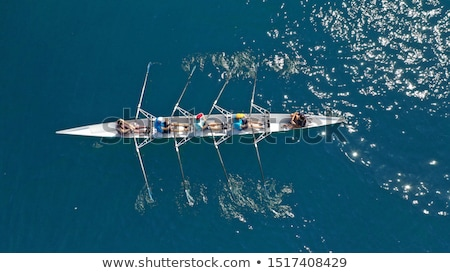 Young man paddling in an open kayak Stock photo © photography33
