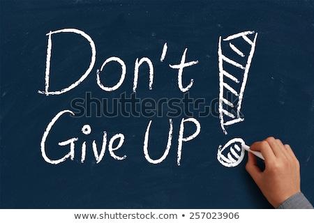 do not give up words written on blackboard stock photo © bbbar