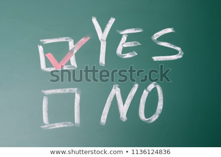 Stock photo: Check box with red tick on a green chalkboard