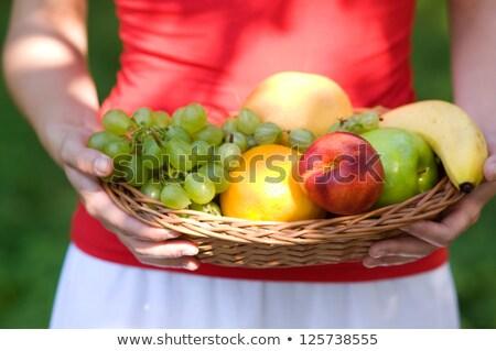 Nő tart nektarin arc divat terv Stock fotó © photography33