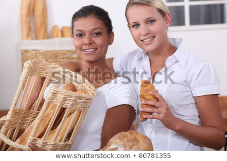 Two shop assistants working in a bakery Stock photo © photography33