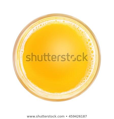 Portakal suyu cam genç kadın yüz Stok fotoğraf © studiofi