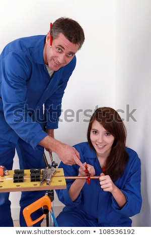 plumber and assistant butting copper pipe stock photo © photography33