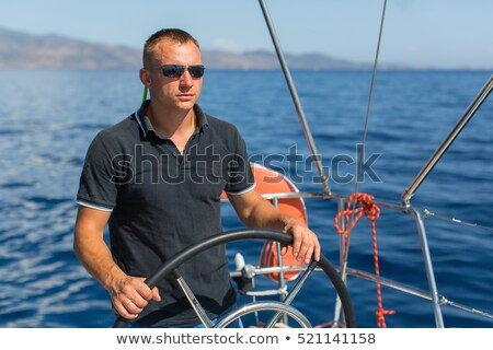 Man at the helm of yacht Stock photo © Anna_Om
