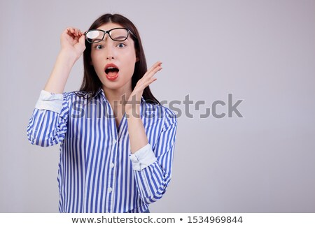 Young corporate woman wearing eyeglasses standing sideways Stock photo © stockyimages