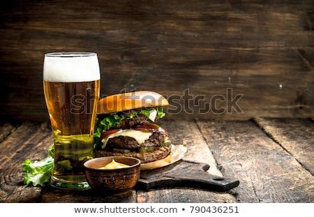 ízletes · hamburger · sültkrumpli · sötét · sajt · kövér - stock fotó © zhekos