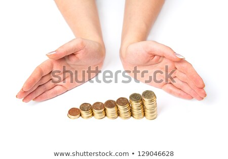 Womens arms around columns of coins stock photo © vlad_star