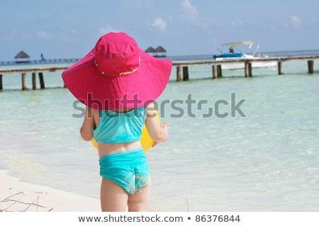 lány · fehér · bikini · sétál · tengerpart · szalmakalap - stock fotó © travnikovstudio