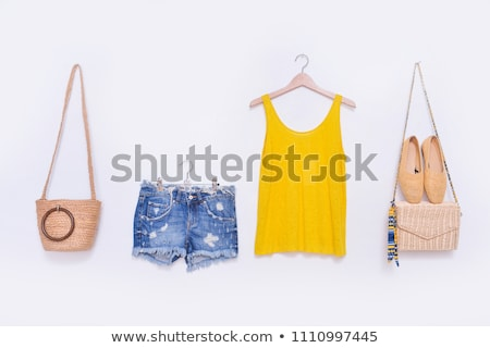 Model in a fashionable blouse and short jean shorts Stock photo © Andersonrise