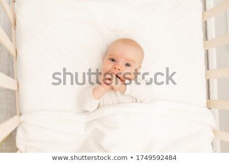 cheerful little girl from her crib Stock photo © taden