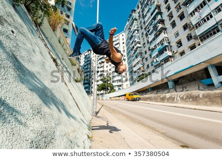 Parkour jumping man on the sky Stock photo © pxhidalgo