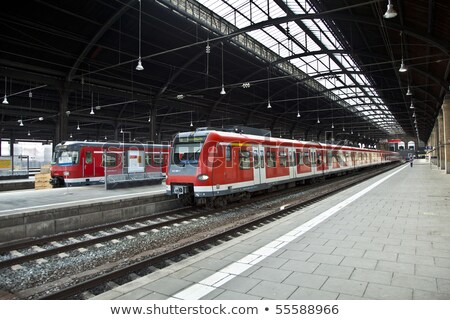 iron classicistic train station from inside with red trains stock photo © meinzahn
