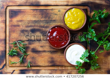 Tomato and ketchup on wooden board Stock photo © stevanovicigor
