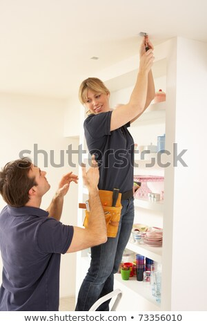 Electrician Teaching Apprentice To Install Light Fitting In Home Stock photo © monkey_business