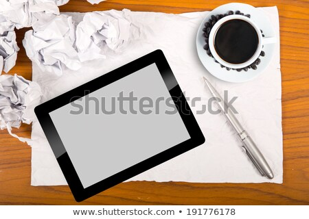 Blank touch pad and  a cup of coffee to start new project stock photo © hin255