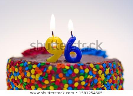 Birthday cake with burning candle number 96 Stock photo © Zerbor