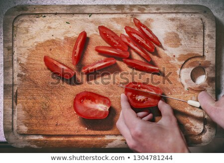 ripe tomato sliced  and knife on table Stock photo © inaquim
