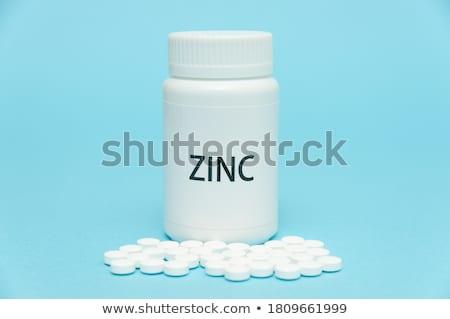 Curare pack pillole blu open Foto d'archivio © tashatuvango