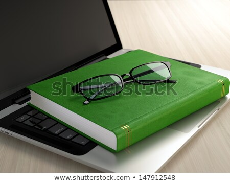 A keyboard with a green button - E-Books Stock photo © Zerbor