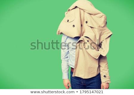 Jonge toevallig man dressing jas geïsoleerd Stockfoto © hsfelix