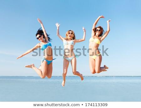 ストックフォト: 女性 · ビキニ · ジャンプ · ビーチ · 夏 · 休日