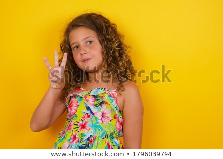 beautiful girl showing number three with fingers of one hand stock photo © giulio_fornasar