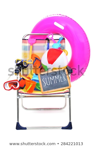 foldable beach chair full of beach items on a white background stock photo © nito