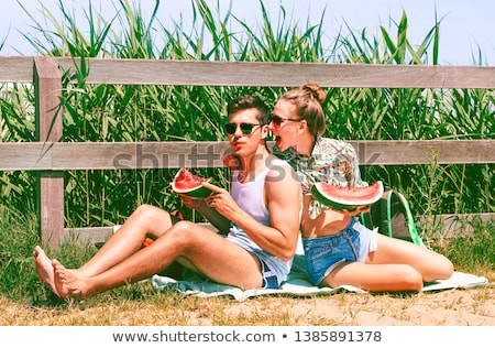 Teasing playful young woman on summer vacation Stock photo © dash