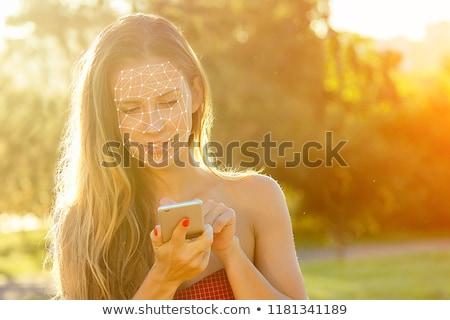 Enamored Girl Texting with Cell Phone Stock photo © feverpitch