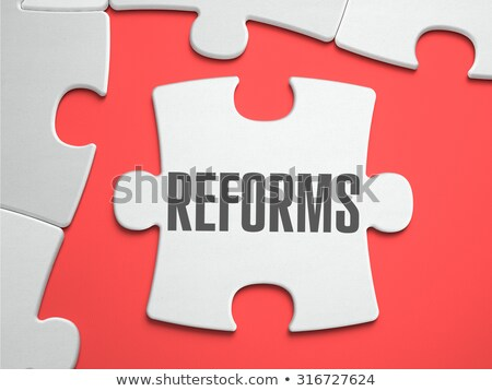 Reforms - Puzzle on the Place of Missing Pieces. Stock photo © tashatuvango