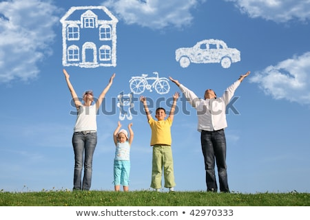 family of four on grass with hands up stock photo © paha_l