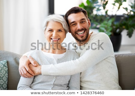 Happy mother with adult son Stock photo © ozgur