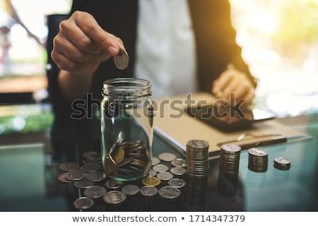 Sikke tasarruf stok fotoğraf kadın para Stok fotoğraf © punsayaporn
