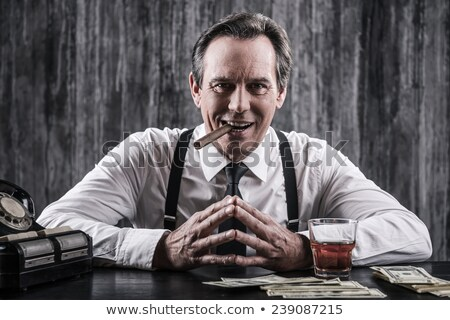 Man with ironic smile stock photo © filipw