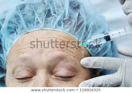 Elderly woman getting Botox injection procedure Stock photo © zurijeta