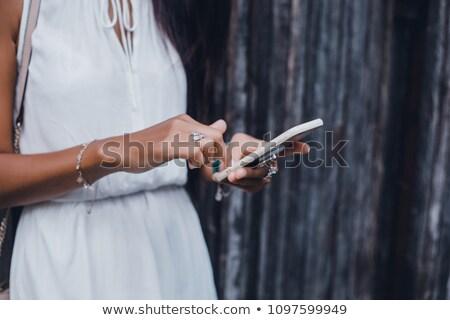 afrikai · nő · okostelefon · iroda · üzlet · kommunikáció - stock fotó © dolgachov