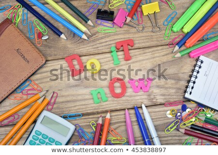 Do it now word and office tools on wooden table Stock photo © fuzzbones0