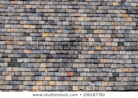 Old roof tiles, blue sky and clouds in the background Stock photo © smuki