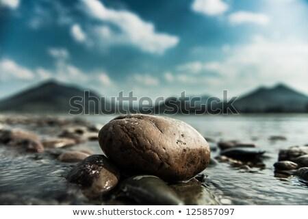 pedras · praia · ilha · horizonte · pôr · do · sol - foto stock © latent