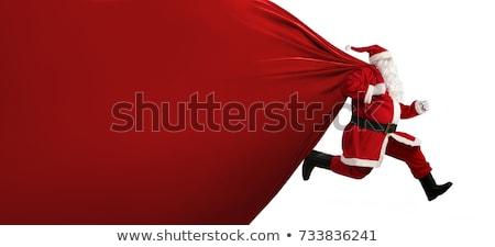 Férfi mikulás tart ajándék zsák fut Stock fotó © deandrobot