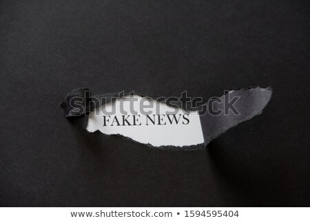 Fake News Torn Paper Concept Stock photo © ivelin