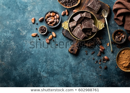 Cocoa beans on dark background, top view, copy space, flat lay Stock photo © yelenayemchuk