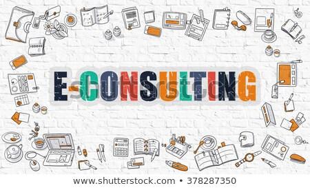 e consulting on white brick wall stock photo © tashatuvango