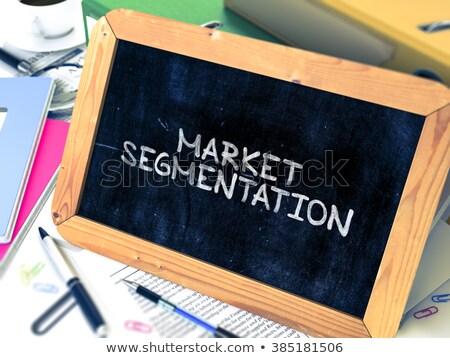 Market Segmentation Handwritten by White Chalk on a Blackboard. Stock photo © tashatuvango