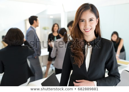 smiling business woman asian businessman team stock photo © qingwa