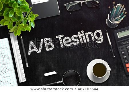 AB Testing on Black Chalkboard. 3D Rendering. Stock photo © tashatuvango