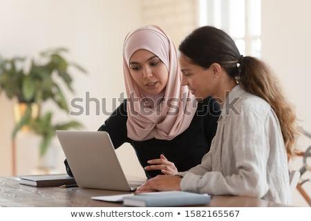 Colegas olhando computador empresário trabalhando sessão Foto stock © IS2