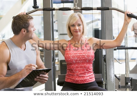 personal · trainer · gymnasium · beneden · machine - stockfoto © monkey_business